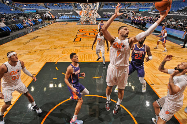 Nikola Vucevic of the Orlando Magic grabs a rebound against the Phoenix Suns on March 24, 2021 at Amway Center in Orlando, Florida. NOTE TO USER:...