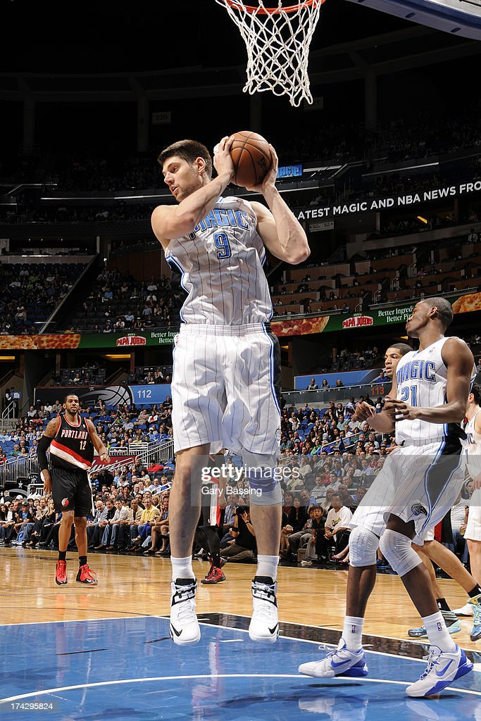 Nikola Vucevic #9 of the Orlando Magic grabs the rebound against the Portland Trail Blazers during the game on February 10, 2013 at Amway Center in Orlando, Florida.