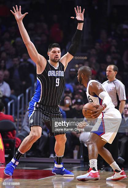Nikola Vucevic of the Orlando Magic guards Chris Paul of the Los Angeles Clippers in the first half of the game at Staples Center on January 11 2017...
