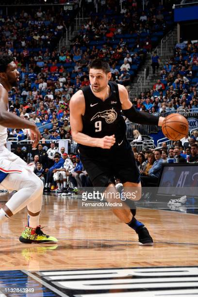 Nikola Vucevic of the Orlando Magic handles the ball against the Philadelphia 76ers on March 25 2019 at Amway Center in Orlando Florida NOTE TO USER...
