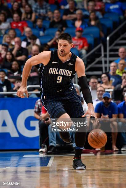 Nikola Vucevic of the Orlando Magic handles the ball against the Chicago Bulls on March 30 2018 at Amway Center in Orlando Florida NOTE TO USER User...