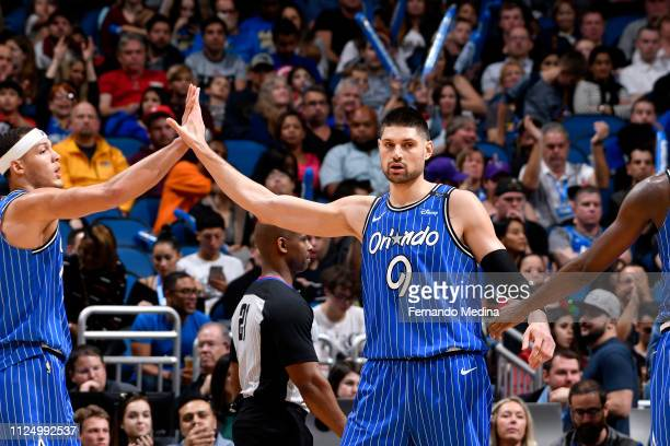Nikola Vucevic of the Orlando Magic high fives his teammates during the game against the Charlotte Hornets on February 14 2019 at Amway Center in...