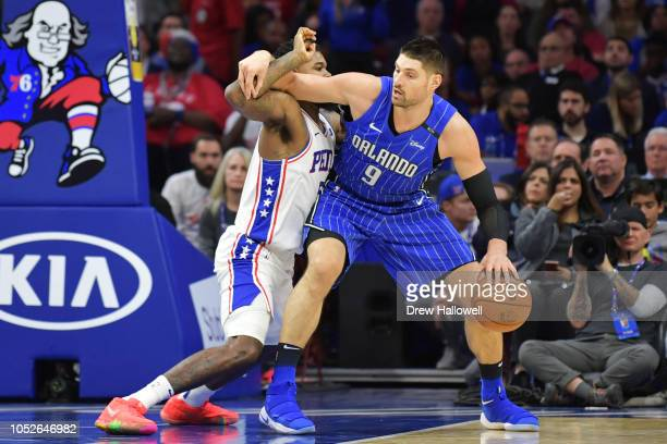 Nikola Vucevic of the Orlando Magic is defended against by Amir Johnson of the Philadelphia 76ers at Wells Fargo Center on October 20 2018 in...