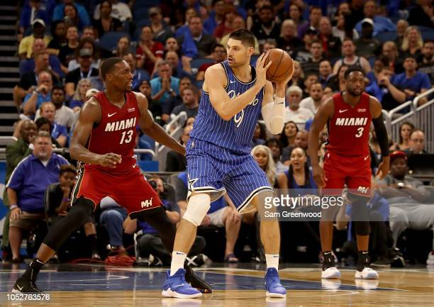 Nikola Vucevic of the Orlando Magic is defended by Bam Adebayo of the Miami Heat during the game at Amway Center on October 17 2018 in Orlando...