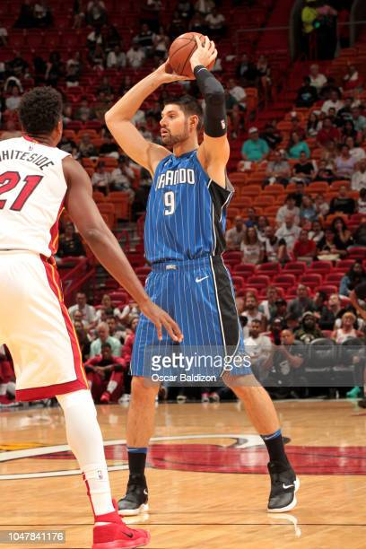 Nikola Vucevic of the Orlando Magic looks to pass against the Miami Heat during a preseason game on October 8 2018 at American Airlines Arena in...
