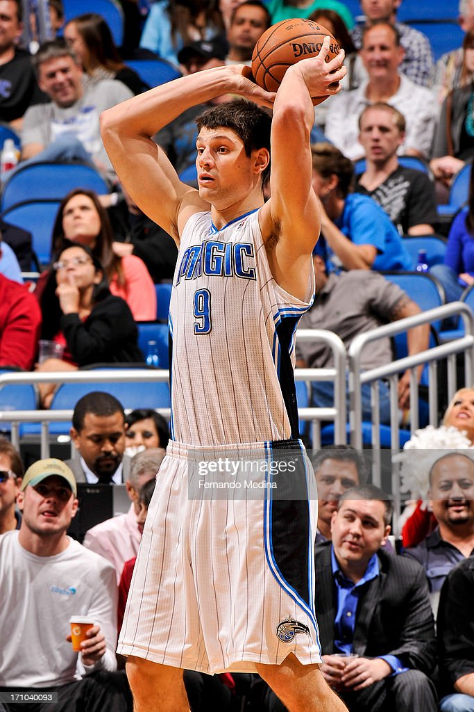 Nikola Vucevic #9 of the Orlando Magic looks to pass the ball against the Washington Wizards on December 19, 2012 at Amway Center in Orlando, Florida.