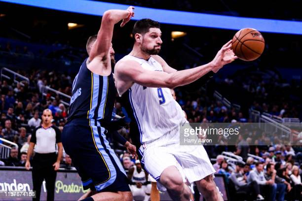 Nikola Vucevic of the Orlando Magic passes the ball during the third quarter against the Memphis Grizzlies at Amway Center on March 22 2019 in...