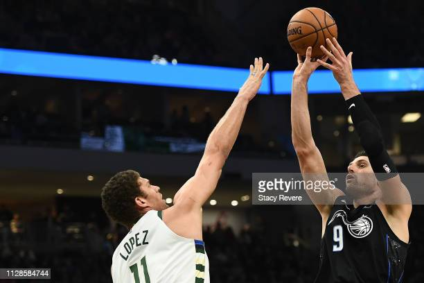 Nikola Vucevic of the Orlando Magic shoots over Brook Lopez of the Milwaukee Bucks during the second half of a game at Fiserv Forum on February 09...