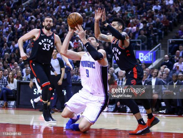 Nikola Vucevic of the Orlando Magic shoots the ball as Danny Green of the Toronto Raptors defends during the first half of an NBA game at Scotiabank...