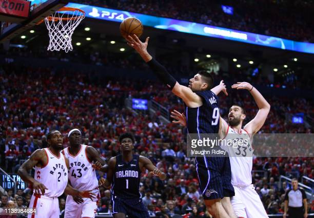 Nikola Vucevic of the Orlando Magic shoots the ball as Marc Gasol of the Toronto Raptors defends during Game Five of the first round of the 2019 NBA...