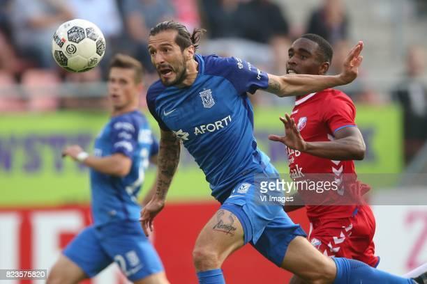 Nikola Vujadinovic of Lech Poznan Gyrano Kerk of FC Utrecht during the UEFA Europa League third qualifying round first leg match between FC Utrecht...