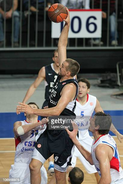 Nikola Vujcic, #18 of Efes Pilsen Istanbul competes with and Boban Marjanovic, #22 of CSKA Moscow during the Turkish Airlines Euroleague Date 5 game...