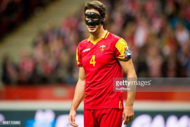 Nikola Vukcevic of Montenegro with the safety mask during the FIFA World Cup 2018 Qualifying Round Group E match between Poland and Montenegro at...