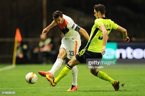 Nikola Vukcevic of SC Braga challenges Dario Srna of Shakhtar Donetsk during the UEFA Europa League Quarter Final first leg match between SC Braga...