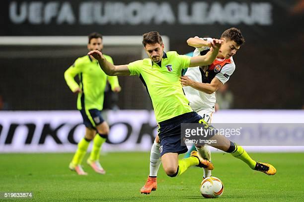 Nikola Vukcevic of SC Braga challenges Maksyn Malyshev of Shakhtar Donetsk during the UEFA Europa League Quarter Final first leg match between SC...