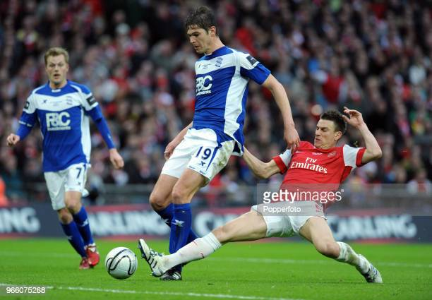 Nikola Zigic of Birmingham City is tackled by Laurent Koscielny of Arsenal during the Carling Cup Final between Arsenal and Birmingham City at...