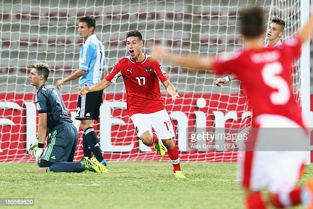 Nikola Zivotic of Austria celebrates his team's first goal during the FIFA U-17 World Cup UAE 2013 Group E match between Argentina and Austria at Al...