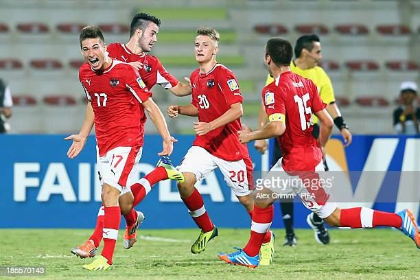 Nikola Zivotic of Austria celebrates his team's first goal with team mates during the FIFA U-17 World Cup UAE 2013 Group E match between Argentina...
