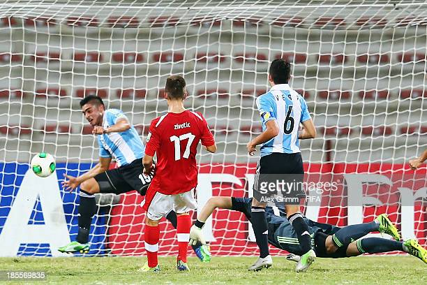 Nikola Zivotic of Austria scores his team's first goal during the FIFA U-17 World Cup UAE 2013 Group E match between Argentina and Austria at Al...