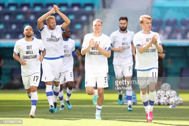 Nikolai Alho of Finland enters the pitch for the warm up wearing 'Get well Christian Eriksen' shirts prior to the UEFA Euro 2020 Championship Group B...
