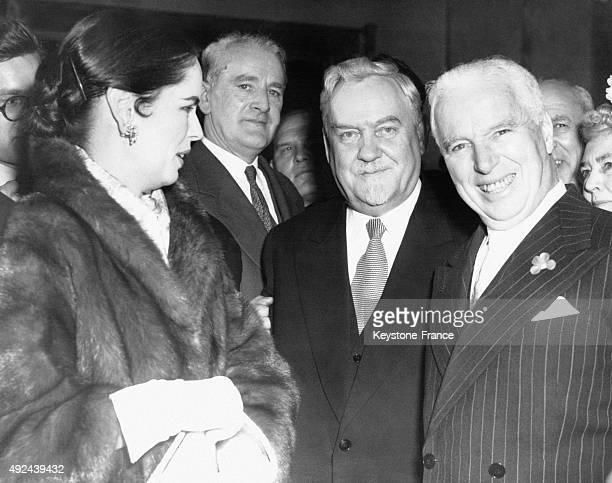 Nikolai Bulganin, Charlie Chaplin and his wife Oona O'Neill Chaplin during a party given by the Russian ambassador at the Claridge Hotel on April 24,...