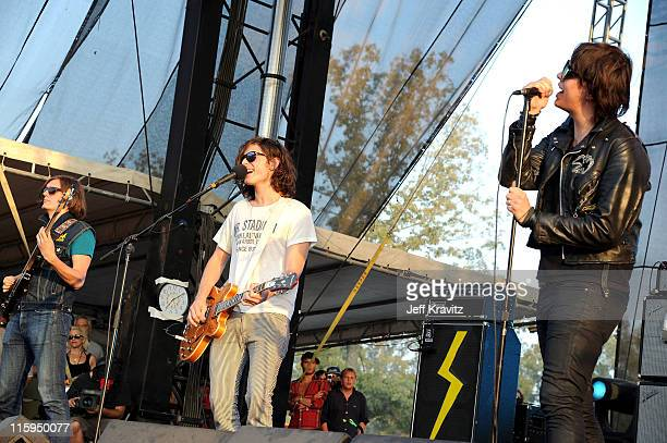 Nikolai Fraiture Nick Valensi and Julian Casablancas of The Strokes perform on stage during Bonnaroo 2011 at Which Stage on June 12 2011 in...