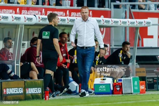 Nikolai Kimmeyer speaks with Head coach Maik Walpurgis of Dynamo Dresden during the Second Bundesliga match between SSV Jahn Regensburg and SG Dynamo...