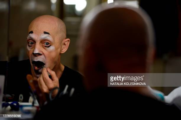 """Nikolai Kormiltsev, clown at the Great Moscow State Circus, applies make up prior to a rehearsal of the show called """"History"""" as the circus prepares..."""