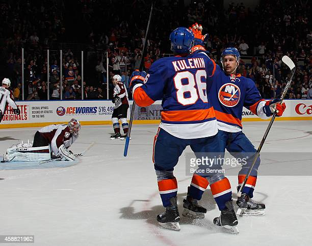 Nikolai Kulemin of the New York Islanders celebrates his shorthanded goal at 1132 of the second period against the Colorado Avalanche and is joined...