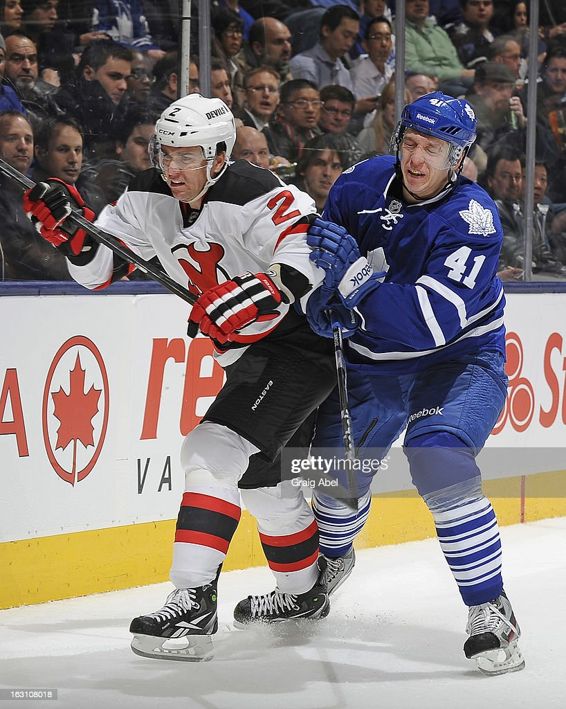 Nikolai Kulemin #41 of the Toronto Maple Leafs battles with Marek Zidlicky #2 of the New Jersey Devils during NHL game action March 4, 2013 at the Air Canada Centre in Toronto, Ontario, Canada.