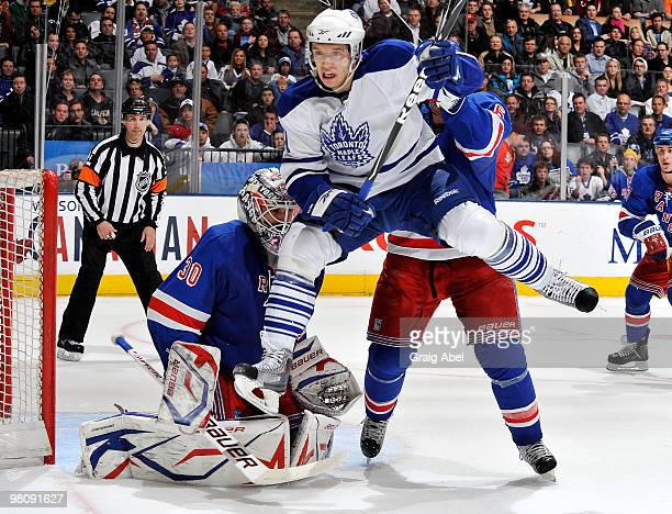 Nikolai Kulemin of the Toronto Maple Leafs jumps in front of goalie Henrik Lundqvist of the New York Rangers during game action March 27 2010 at the...