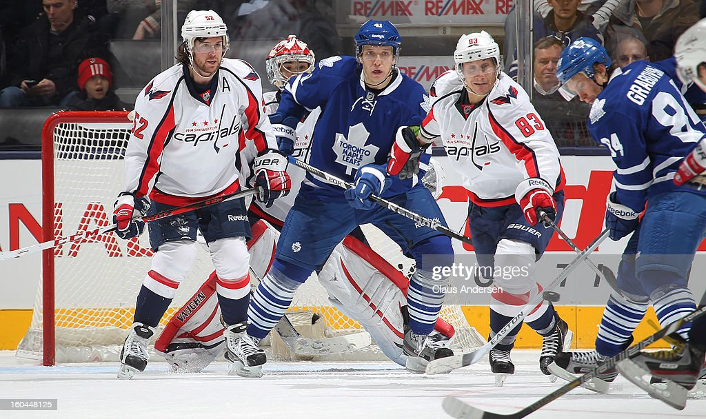Nikolai Kulemin #41 of the Toronto Maple Leafs waits to tip an incoming shot while standing between Mike Green #52 and Jay Beagle #83 of the Washington Capitals in a game on January 31, 2013 at the Air Canada Centre in Toronto, Canada. The Maple Leafs defeated the Capitals 3-2.