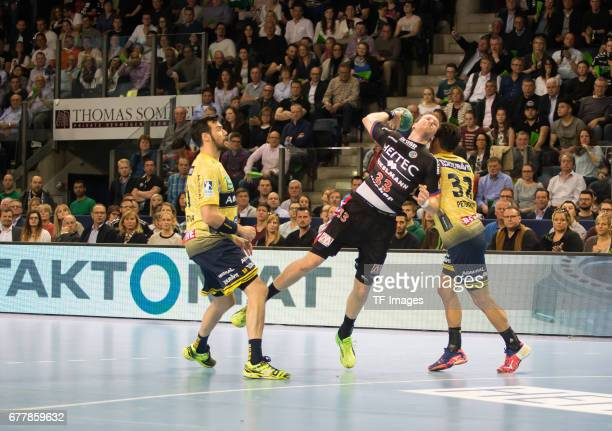 Nikolai Link of Erlangen and Alexander Petersson of RheinNeckar Loewen battle for the ball during the match between the HC Erlangen and the...