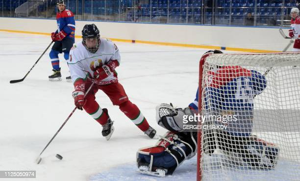 Nikolai Lukashenko , son of Belarus President Alexander Lukashenko, takes part in an ice hockey match with his father and the Russian president at...