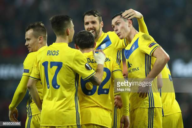 Nikolai Signevich of FC Bate Borisov celebrates with teammates after scoring his sides second goal during the UEFA Europa League group H match...