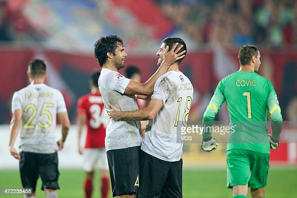 Nikolai Topor-Stanley and Iacopo La Rocca of Western Sydney Wanderers celebrate after the AFC Asian Champions League Group H match between Guangzhou...
