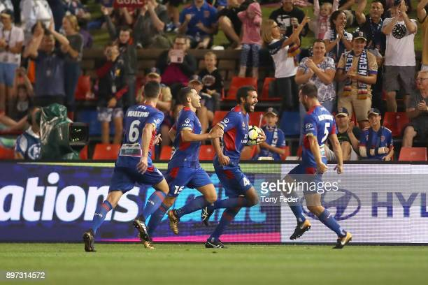 Nikolai ToporStanley of the Jets celebrates with team mates during the round 12 ALeague match between the Newcastle Jets and the Western Sydney...