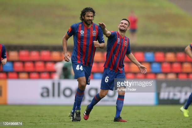Nikolai Topor-Stanley of the Newcastle Jets celebrates his goal with Steven Ugarkovic during the round 18 A-League match between the Newcastle Jets...