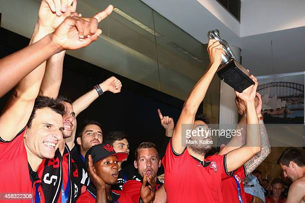 Nikolai ToporStanley of the Western Sydney Wanderers holds aloft the trophy as the team arrives at Sydney International Airport from Saudi Arabia...