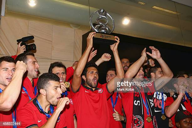 Nikolai ToporStanley of the Western Sydney Wanderers holds aloft the trophy as the team celebrates on arrival at Sydney International Airport from...