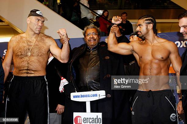 Nikolai Valuev of Russia and David Haye of Britain face each other during the weigh in at the Mercado shopping center on November 6 2009 in Nuremberg...