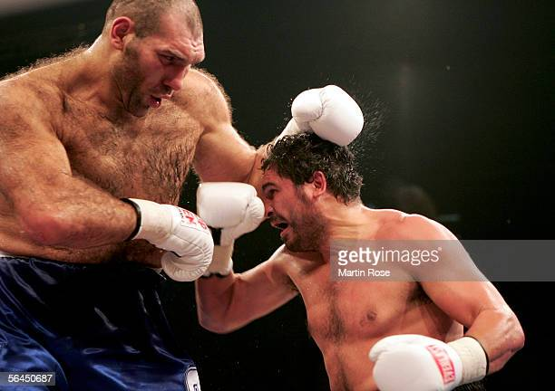 Nikolai Valuev of Russia and John Ruiz of USA exchange punches during their WBA Heavyweight Fight at the Max-Schmeling Hall on December 17, 2005 in...