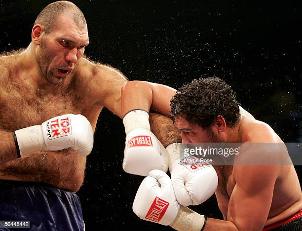 Nikolai Valuev of Russia and John Ruiz of USA seen in action during their WBA Heavyweight Fight at the Max-Schmeling Hall on December 17, 2005 in...