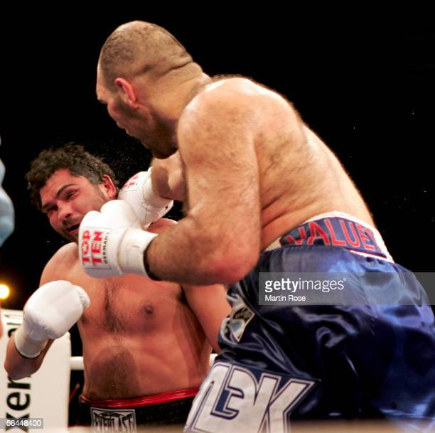 Nikolai Valuev of Russia hits John Ruiz of USA during their WBA Heavyweight Fight at the Max-Schmeling Hall on December 17, 2005 in Berlin, Germany.