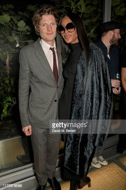 Nikolai Von Bismarck and Naomi Campbell attend the Dior Sessions book launch on October 01 2019 in London England