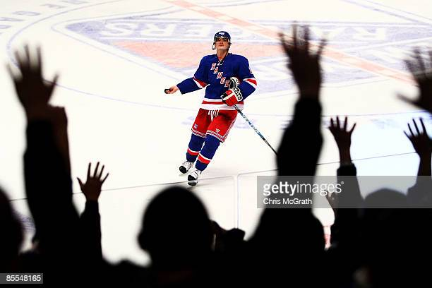 Nikolai Zherdev of the New York Rangers throws a puck into the crowd after defeating the Buffalo Sabres during their game on March 21 2009 at Madison...