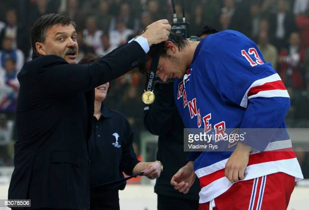 Nikolai Zherdev receives the gold medal from the hands of the IIHF President Rene Fasel after winning 4:3 at the Victoria Cup game between Metallurg...