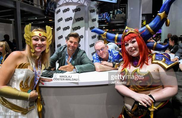"""Nikolaj Coster-Waldau and Liam Cunningham pose with fans at """"Game Of Thrones"""" Comic Con Autograph Signing 2019 on July 19, 2019 in San Diego,..."""