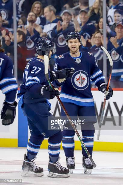 Nikolaj Ehlers and Josh Morrissey of the Winnipeg Jets celebrate a first period goal against the Philadelphia Flyers at the Bell MTS Place on...