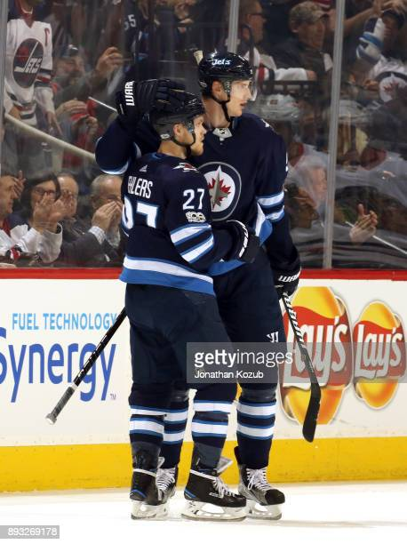 Nikolaj Ehlers and Tyler Myers of the Winnipeg Jets celebrate a third period goal against the Chicago Blackhawks at the Bell MTS Place on December 14...